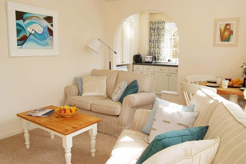 The open plan living-room is light and comfortably furnished.