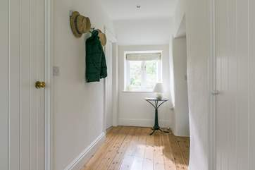 The bright and light hallway has plenty of room for all your coats, shoes, walking boots and more.