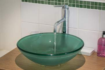 The contemporary sink in the en suite.