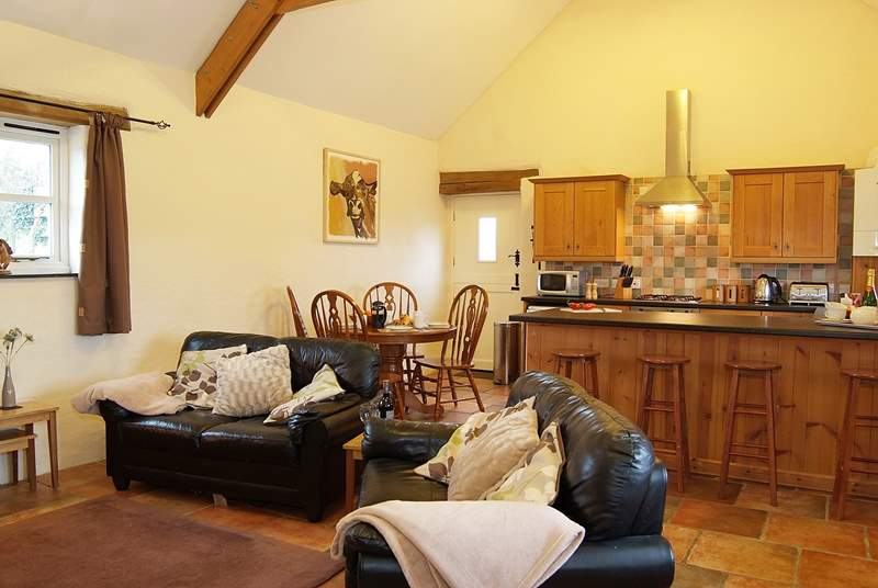 The spacious open plan living-room.