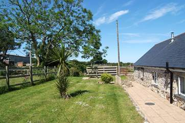 The garden at the back of the cottage is fully enclosed and now includes a hot tub at the end of the garden by the small bush.