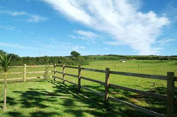 The garden overlooks the surrounding fields and lovely countryside.
