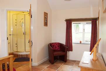 The master bedroom is spacious and light with countryside views.