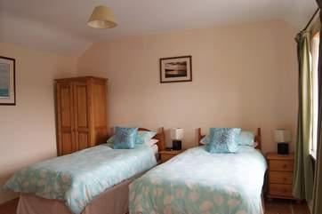 The ground floor bedroom has 'zip and link' (double or twin) beds, and access to the bathroom next door.