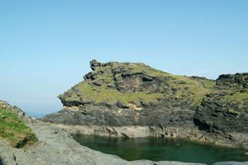 Boscastle's dog-leg harbour leads out to open sea.