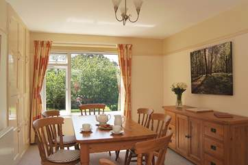 The dining-room also overlooks the pretty garden.