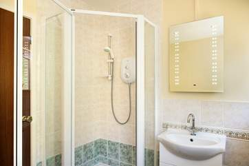 The family bathroom is on the ground floor and has a separate shower cubicle