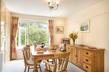 The dining room looks out onto the gorgeous garden