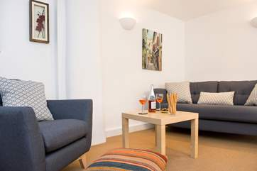 The sitting-room is the ideal place to relax after a busy day exploring the North Cornish Coast.