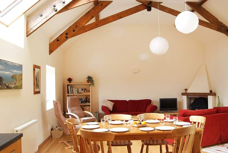 The open plan living-room is comfortably furnished and very spacious.