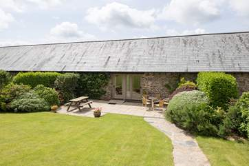There is a sunny patio in front of the cottage which leads onto this beatiful lawn.