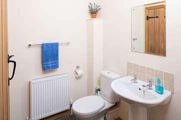 The cloakroom is off the utility-room.