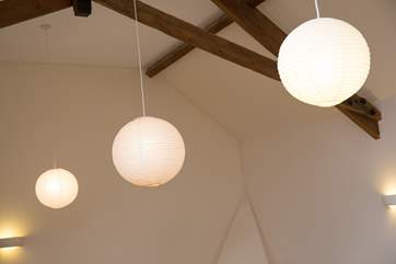 Interesting lighting and a high-beamed ceiling.
