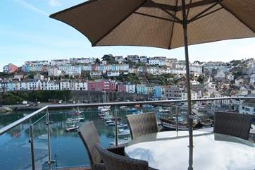The first floor terrace looks out to Torbay and across the bustling harbour to the terraced cottages of Brixham above.