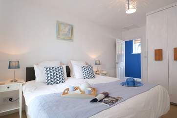 Bedroom 1 has 'zip and link' beds (3' twin beds or a 6' super-king size double bed) and patio doors onto the deck.