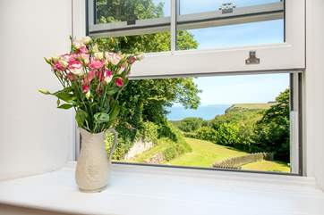 The master bedroom enjoys wonderful views over the garden and out to sea