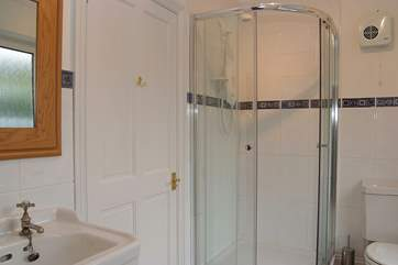 This shower-room is en suite to Bedroom 1 and can also be accessed from the hall.