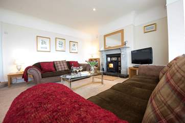 The cosy end of the sitting-room.