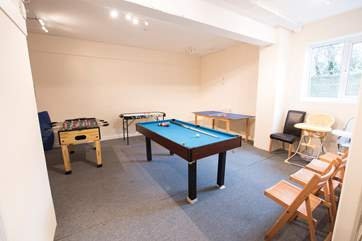The games-room has a half-size pool table.