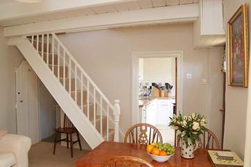 A typically steep cottage staircase leads up to the first floor.