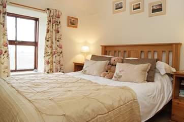 The double bedroom (Bedroom 1) has a lovely outlook across fields towards the reservoir.