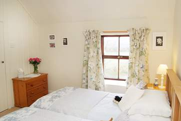 The twin bedroom also has wonderful countryside views towards the reservoir.