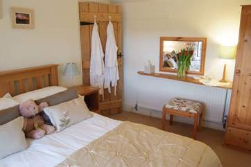 The double bedroom with white bathrobes for your use.