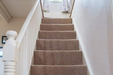 The cottage stairs lead up to the two bedrooms, there is a small step up on either side.