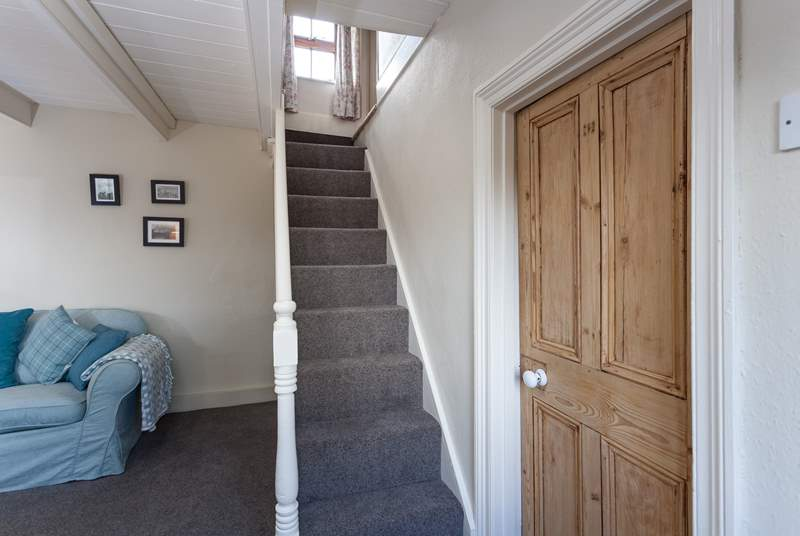 The steep cornish staircase takes you up to the first floor, there is a small step either side of the stairs, leading into the bedrooms.