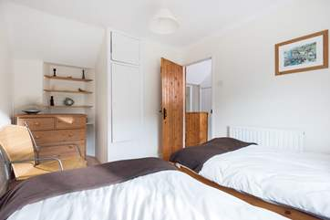 The twin bedroom is across the landing from the double room.
