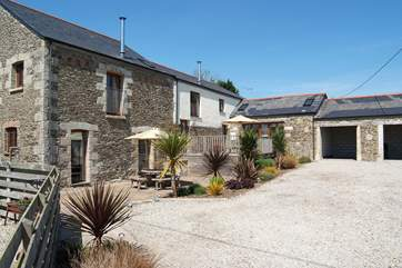 Each cottage has its own south-facing patio looking out over the shared lawn and countryside.