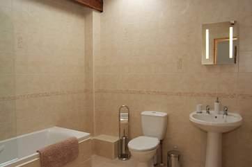 The spacious family bathroom.