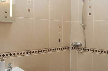 This fully tiled wet-room is en suite to the ground floor bedroom.