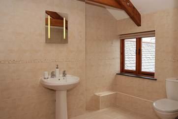 This spacious bathroom is en suite to Bedroom 2.