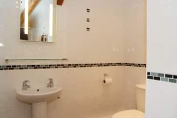 The fully tiled shower-room.