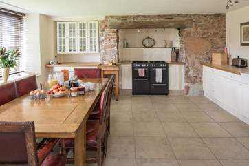 The spacious kitchen makes cooking and serving any meal a real pleasure.