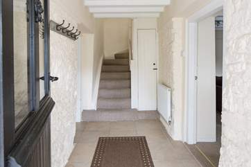 The entrance hall offers a great space to de-boot and hang your coats up ready to relax, bath and dine.