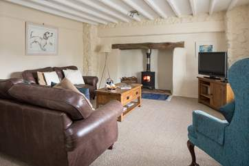 After an action-packed day, this welcoming living room with glowing wood burner awaits.