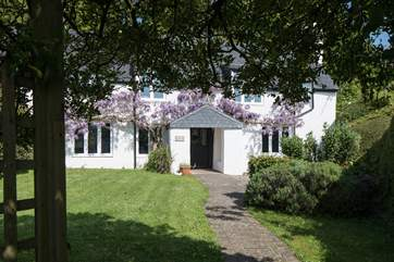 Such a stunning cottage awaits as you step through the entrance gate.