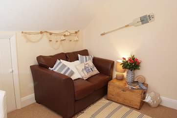 The cosy sitting-room is a little home-from-home.