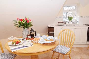 The kitchen/dining-room is bright and cheerful.