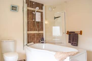 The bath with fitted shower can be accessed from both sides.