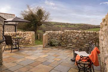 The enclosed courtyard is a wonderful sun trap and has lovely views over rolling countryside.