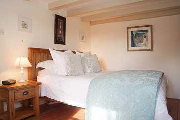 The lovely ground floor bedroom has sumptuous linens and a wonderfully comfortable mattress.