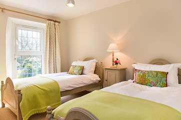 Pretty bedroom 2 enjoys views over the garden