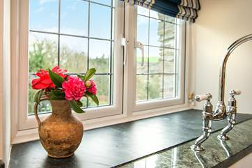 From the kitchen you can enjoy the view of the garden and the surrounding countryside