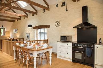 The kitchen has a range cooker- perfect for your holiday catering