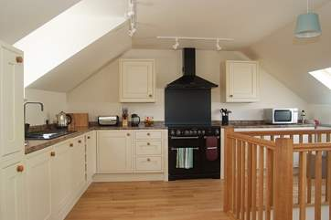 Oak flooring and a bespoke staircase and banisters show the quality of the cottage.