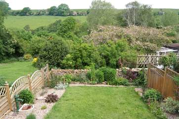 The attractive enclosed garden with countryside views beyond.