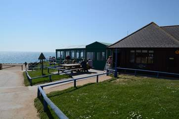 The Hive beach cafe at Burton Bradstock is well worth a visit for delicious seafood, or cakes and ice cream.